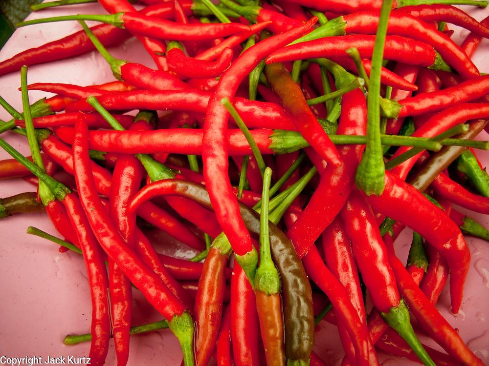 06 APRIL 2010 - NAKHON PHANOM, THAILAND: Chilis for sale in the market in Nakhon Phanom, Thailand.    PHOTO BY JACK KURTZ