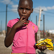Child in colourful clothes in township New Brighton, South Africa