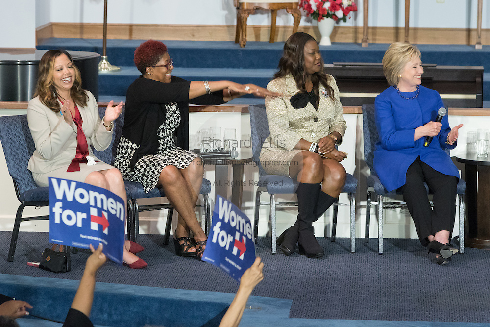 Democratic presidential candidate Hillary Rodham Clinton with Sybrina Fulton, Maria Hamilton, and Lucy McBath,  share a laugh during the Breaking Down Barriers Forum on gun violence at Central Baptist Church February 23, 2016 in Columbia, South Carolina. The event was attended by mothers who lost their children to gun violence and police incidents.
