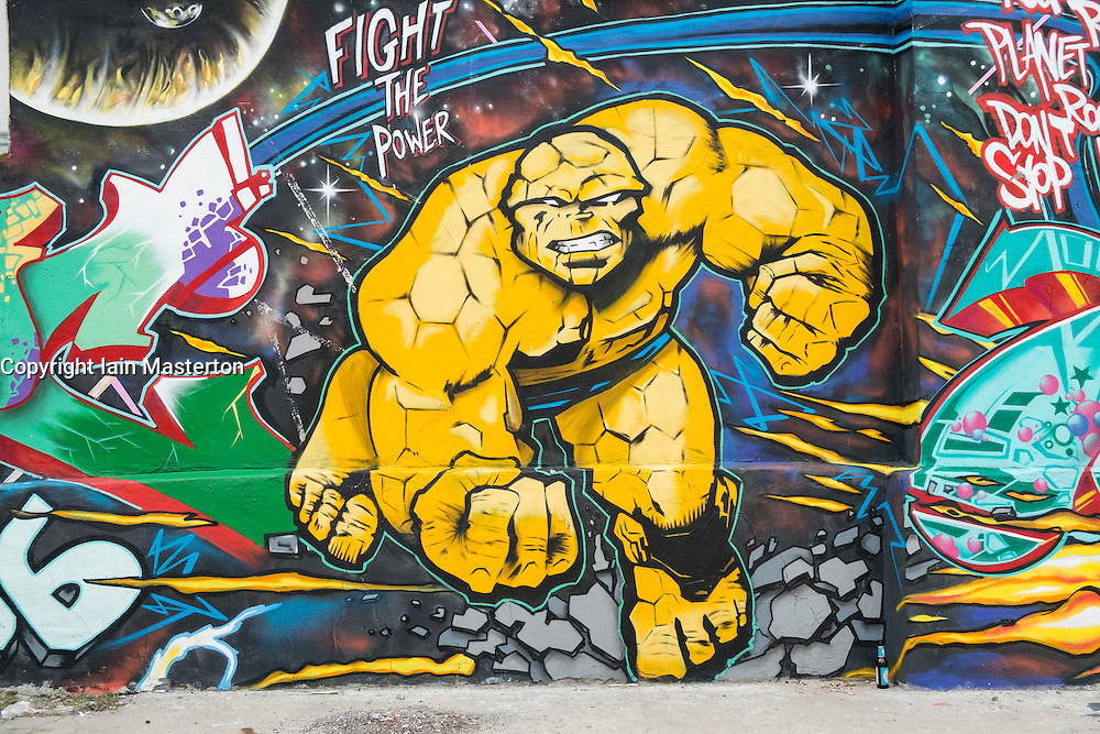 Street art featuring comic book character painted on wall in Kreuzberg Berlin Germany