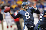 SEATTLE - NOVEMBER 28:  Quarterback Matt Hasselbeck #8 of the Seattle Seahawks drops back to pass against the Buffalo Bills at Qwest Field on November 28, 2004 in Seattle, Washington. The Bills defeated the Seahawks 38-9. ©Paul Anthony Spinelli *** Local Caption *** Matt Hasselbeck