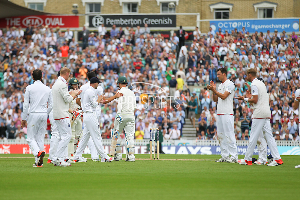 Michael Clarke captain of Australia walks to the crease for his last test match and is applauded by the England players during the 1st day of the 5th Investec Ashes Test match between England and Australia at The Oval, London, United Kingdom on 20 August 2015. Photo by Phil Duncan.