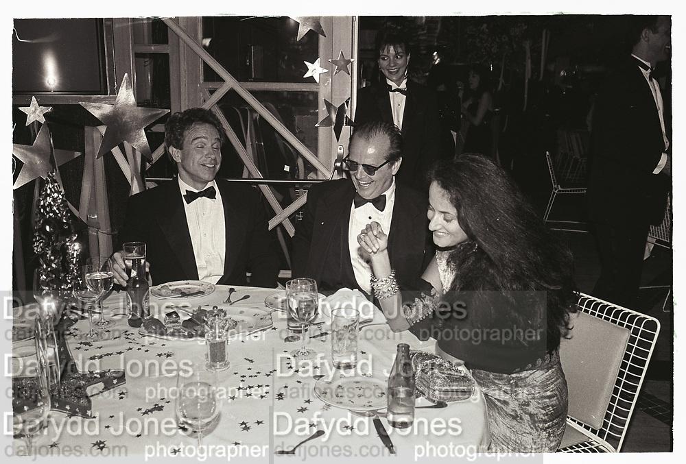 Warren Beatty, Jack Nicholson & Isobel Goldsmith at Swifty Lazar's Oscar Night party. Spago. Los Angeles. March 1990.