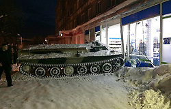 January 10, 2018 - Apatity, Murmansk Region, Russia - January 10, 2018. - Russia, Murmansk Region, Apatity. - Man rammed into a shopfront after losing control of the stolen armored vehicle and hitting a parked car in the Murmansk Region. The man then entered the store to steal a bottle of wine, with which he was later arrested. The stolen armored personnel carrier belonged to a local paramilitary sports society driving school. Photo: hibiny.com (Credit Image: © Russian Look via ZUMA Wire)