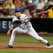 NEW YORK, NEW YORK - July 07: Wilmer Flores #4 of the New York Mets makes an out while fielding at first base during the Washington Nationals Vs New York Mets regular season MLB game at Citi Field on July 07, 2016 in New York City. (Photo by Tim Clayton/Corbis via Getty Images)