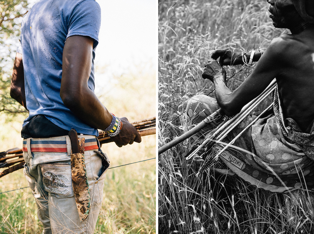 Benja, 20, a member of the Hadza tribe, goes hunting in the Yaeda valley area in Northern Tanzania. Many of the clothes thrown out or given to charity shops in the West, end up for sale in Africa. The Hadza had a real love of anything like jewelry or beads or things that sparkle, so it wasn't surprising to see a male member of the tribe such as Benja wearing something like these 'Chanel' trousers. Photo by Greg Funnell, March 2016.