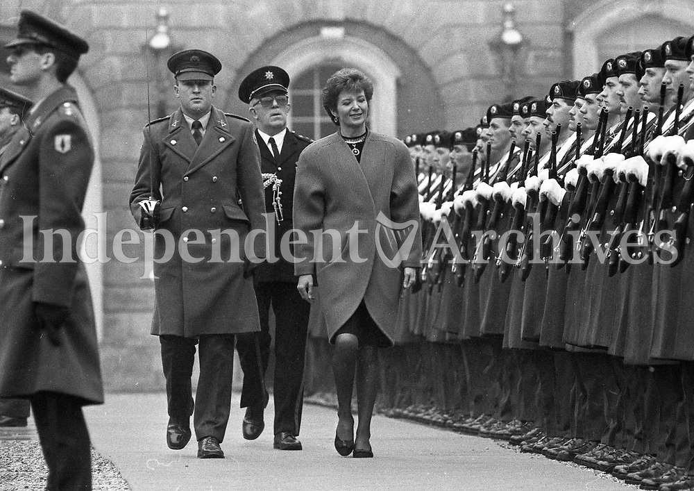 President Mary Robinson inspects a Guard of Honour drawn from the 2nd Infantry Battalion, Cathal Brugha Barracks accompanied by Captain Tom Boyce and Colonel Patrick McNulty ADC to the President, after the Inauguration at St Partick's Hall, Dublin Castle, 03/12/1990 (Part of the Independent Newspapers Ireland/NLI Collection).