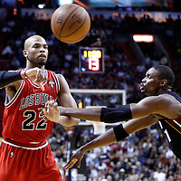 06 March 2011: Chicago Bulls forward Taj Gibson (22) passes the ball over Miami Heat power forward Chris Bosh (1) during the Chicago Bulls 87-86 victory over the Miami Heat at the AmericanAirlines Arena, Miami, Florida, USA.