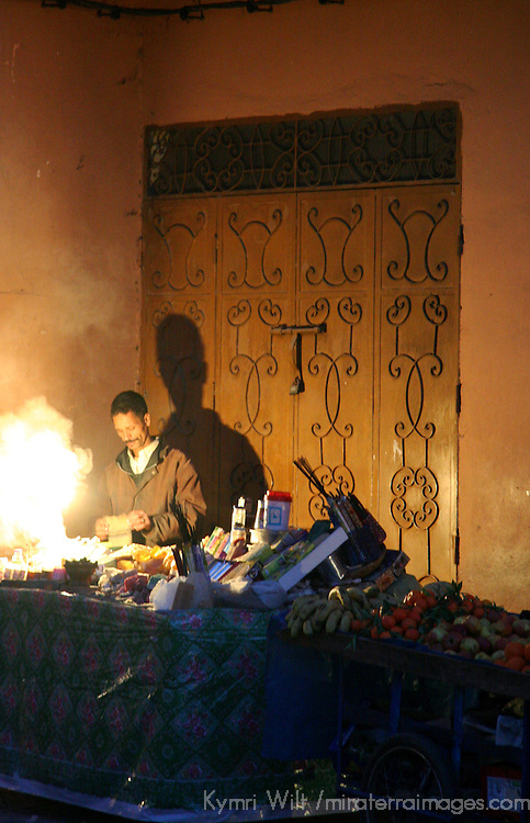 North Africa, Africa, Morocco, Marrakesh.  A vendor makes and sells incense and perfumes at the Djeema el Fna.
