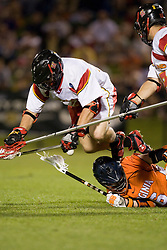 Virginia attackman Ben Rubeor (6) gets stomped on by Maryland midfielder Ryne Adolph (22) while fighting for a loose ball.  The #3 ranked Virginia Cavaliers defeated the #8 ranked Maryland Terrapins 11-8 in the semi finals of the Men's 2008 Atlantic Coast Conference tournament at the University of Virginia's Klockner Stadium in Charlottesville, VA on April 25, 2008.