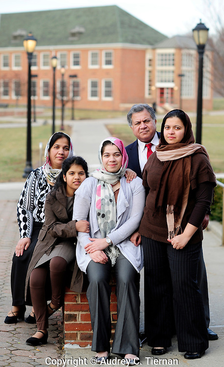 Staten Island, NY:  Saturday, February 26, 2012-- Zujaja Tauqeer, 21, (center) of Staten Island, a senior at Macaulay Honors College at Brooklyn College, is the only scholar from a New York college chosen for the Rhodes Scholarship in 2011.  She is with her family from left: : Dr. Ayesha Tauqeer (her mother), Sabaha Ahmad, 11 (her sister), her father Dr. Tauqeer Ahmad and sister Khaula Tauqeer, 24(sister in brown clothing).  © Audrey C. Tiernan