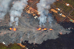 2018 05 24 - Pahoa, Hawaii, USA:  Fissure 7 reactivated with vigorous fountaining, sending flows through Leilani Estates once again, consuming several homes and property.<br />