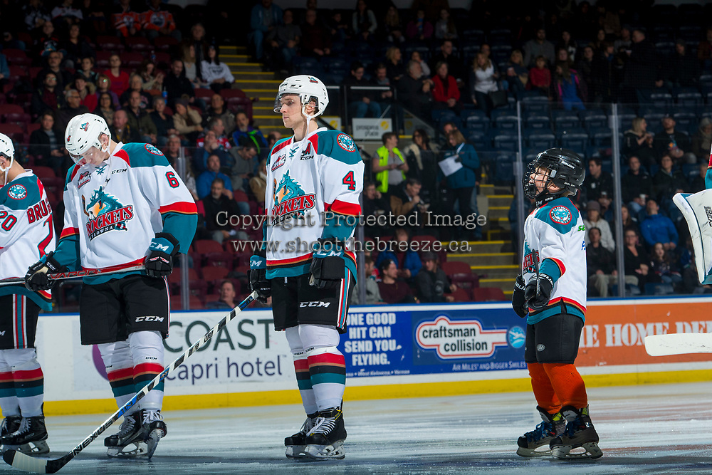 KELOWNA, CANADA - DECEMBER 30: The Pepsi Save On Foods player of the game lines up alongside Gordie Ballhorn #4 of the Kelowna Rockets against the Victoria Royals on December 30, 2017 at Prospera Place in Kelowna, British Columbia, Canada.  (Photo by Marissa Baecker/Shoot the Breeze)  *** Local Caption ***