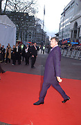 Stephen Fry, Arriving for the Baftas, Leicester Sq. 23  February 2003. © Copyright Photograph by Dafydd Jones 66 Stockwell Park Rd. London SW9 0DA Tel 020 7733 0108 www.dafjones.com