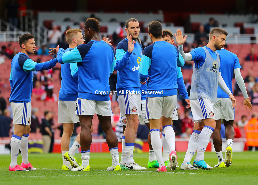 May 16th 2017, Emirates Stadium, Highbury, London, England;  EPL Premier League football, Arsenal FC versus Sunderland; Sunderland players high five each other as they return to the dressing room before kick off