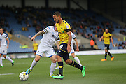 Oxford United midfielder Kemar Roofe (4) surges forward during the Sky Bet League 2 match between Oxford United and AFC Wimbledon at the Kassam Stadium, Oxford, England on 10 October 2015.