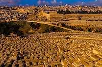 Gravestones (150,000 graves), Jewish Cemetery on the Mount of Olives, with the Dome of the Rock on the Temple Mount in background, Jerusalem, Israel.