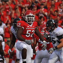 Sep 7, 2009; Piscataway, NJ, USA; Rutgers defensive end Eric Legrand (52) yells after a tackle for loss during the first half of Rutgers game against Cincinnati in NCAA college football at Rutgers Stadium.