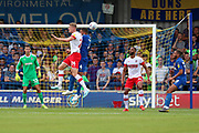 AFC Wimbledon defender Rod McDonald (4) battles for possession with Rotherham United attacker Michael Smith (24) during the EFL Sky Bet League 1 match between AFC Wimbledon and Rotherham United at the Cherry Red Records Stadium, Kingston, England on 3 August 2019.