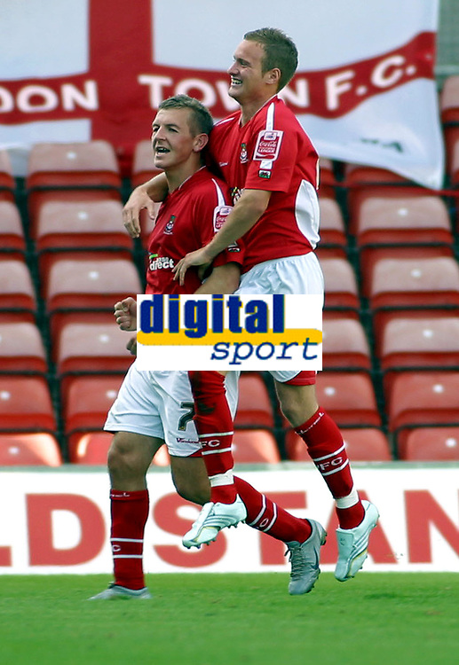 Photo: Dave Linney.<br />Wrexham v Swindon Town. Coca Cola League 2. 09/09/2006.Wrexham's Mark Jones(L) celebrates with  Matty Done after putting the Dragons 2-0 ahead.