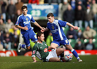 David Norris of Plymouth on floor tackless Cardiffs Jason Koumas<br /> <br /> Photo: Richard Eaton.<br /> <br /> Plymouth Argyle v Cardiff City. Coca Cola Championship. 18/03/2006.