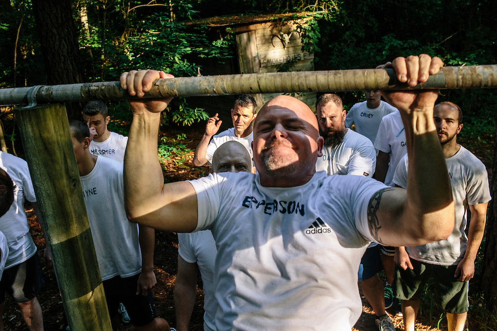 Participants in the Extreme SEAL  Experience start hell night, 24-hours of physical endurance, by performing sit-ups, push-ups and pull-ups according to the requirements of the Navy Seal program.