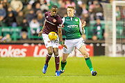 Arnaud Djoum (#10) of Heart of Midlothian shields the ball from Vykintas Slivka (#8) of Hibernian FC during the Ladbrokes Scottish Premiership match between Hibernian FC and Heart of Midlothian FC at Easter Road Stadium, Edinburgh, Scotland on 29 December 2018.