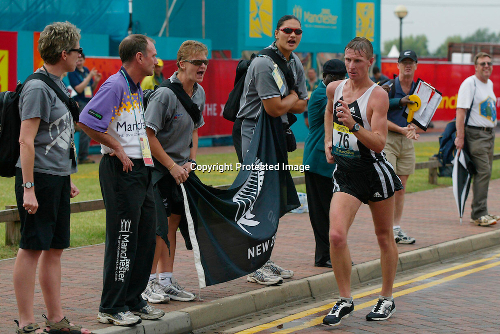 24 July 2002, Commonwealth Games, Men's 50km Walk-Final, Manchester, England.<br />Craig Barrett of New Zealand passes support from other New Zealand Athletes. He finished second to take the silver medal.<br />Pic: Sandra Teddy/Photosort