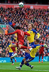LIVERPOOL, ENGLAND - Saturday, September 22, 2018: Liverpool's Mohamed Salah is challenged by Southampton's Jannik Vestergaard and Cedric Soares during the FA Premier League match between Liverpool FC and Southampton FC at Anfield. (Pic by Jon Super/Propaganda)