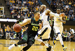 Jan 9, 2018; Morgantown, WV, USA; Baylor Bears guard Manu Lecomte (20) drives down the lane during the first half against the West Virginia Mountaineers at WVU Coliseum. Mandatory Credit: Ben Queen-USA TODAY Sports