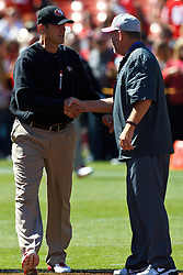 SAN FRANCISCO, CA - OCTOBER 07: Head coach Jim Harbaugh of the San Francisco 49ers (left) shakes hands with head coach Chan Gailey of the Buffalo Bills (right) before the game at Candlestick Park on October 7, 2012 in San Francisco, California. The San Francisco 49ers defeated the Buffalo Bills 45-3. Photo by Jason O. Watson/Getty Images) *** Local Caption *** Jim Harbaugh; Chan Gailey
