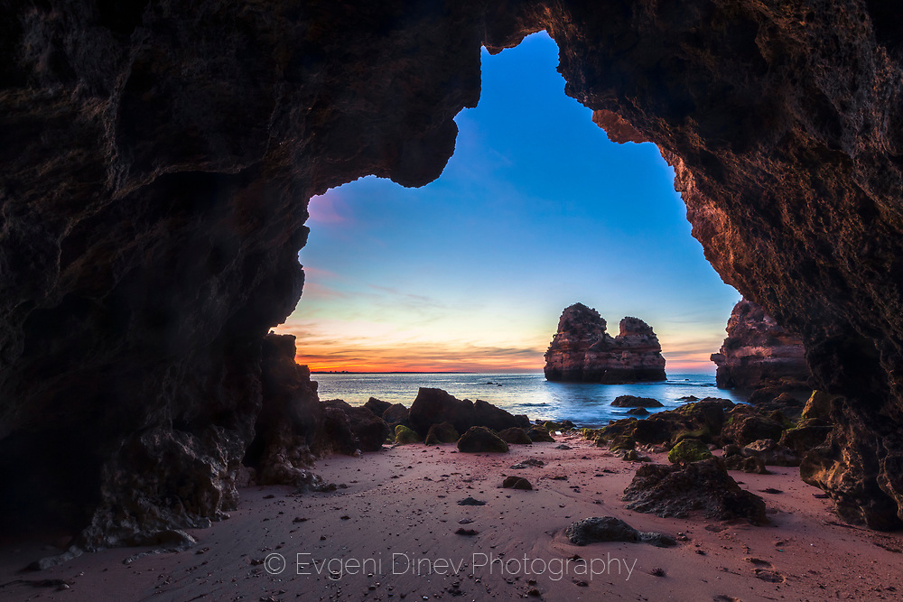 Cave ark by the beach of Lagos at sunrise