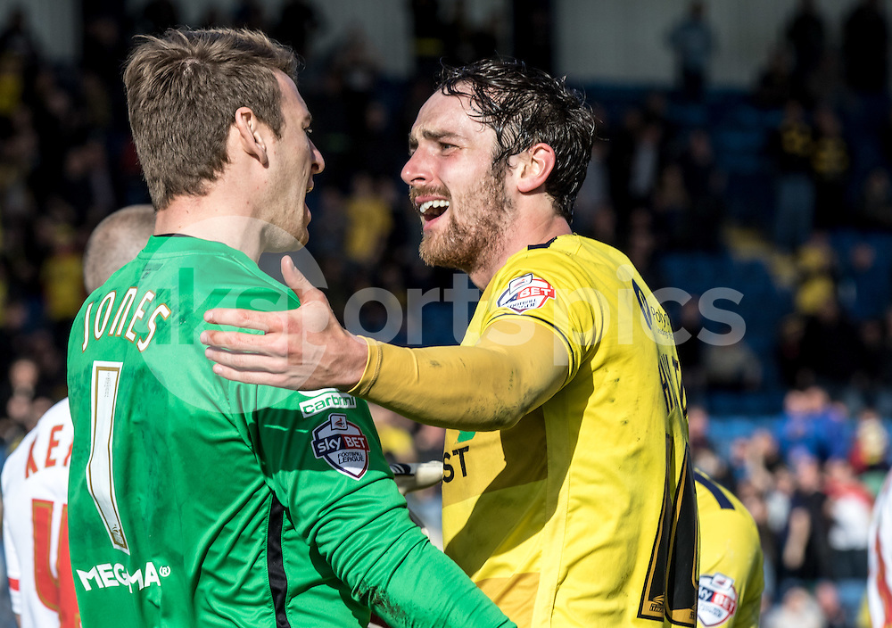 Danny Hylton of Oxford United and Goalkeeper Jamie Jones of Stevenage have words after Jones gives away the penalty during the Sky Bet League 2 match between Oxford United and Stevenage at the Kassam Stadium, Oxford, England on the 25th March 2016. Photo by Liam McAvoy.