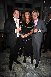 Left to right, CHARLES WORTHINGTON, TRACEY EMIN and ALLAN PETERS at a dinner hosted by Ruinart in honour of Amanda Wakely at The Connaught, Carlos Place, London on 20th October 2010.