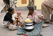 Women collecting food aid at Mother Teresa's Mission for the Poor in Calcutta, India