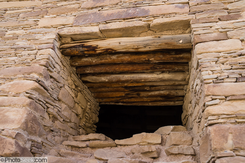 Puebloan stone window. Chetro Ketl was a massive stone building (Puebloan Great House) occupied from 950-1250s AD, now preserved at Chaco Culture National Historical Park, New Mexico, USA. This park hosts the densest and most exceptional concentration of pueblos in the American Southwest and is a UNESCO World Heritage Site. Chaco Canyon is in remote northwestern New Mexico, between Albuquerque and Farmington, USA. From 850 AD to 1250 AD, Chaco Canyon advanced then declined as a major center of culture for the Ancient Pueblo Peoples. Chacoans quarried sandstone blocks and hauled timber from great distances, assembling fifteen major complexes that remained the largest buildings in North America until the 1800s. Climate change may have led to its abandonment, beginning with a 50-year drought starting in 1130.