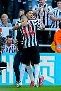 Ayoze Perez (#17) of Newcastle United celebrates Newcastle United's second goal (2-0) with Miguel Almiron (#24) of Newcastle United during the Premier League match between Newcastle United and Southampton at St. James's Park, Newcastle, England on 20 April 2019.