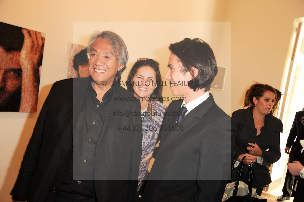 Left to right, SIR DAVID & LADY TANG and his son EDWARD TANG at the BRIC art sale preview (Brazil, Russia, India & China, the acronym BRIC here refers to the burgeoning contemporary art practices within these four countries.) organised by Phillips de Pury & Company at The Saatchi Gallery, London on 17th April 2010.