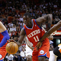 21 January 2012: Philadelphia Sixers point guard Jrue Holidays (11) drives past Miami Heat center Joel Anthony (50) during the Miami Heat 113-92 victory over the Philadelphia Sixers at the AmericanAirlines Arena, Miami, Florida, USA.