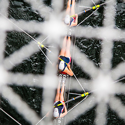 SEATTLE, WASHINGTON - MAY 3: A women's crew rows under the Montlake Bridge on the opening day of boating season during the 2014 Windermere Cup. (Photo by Christopher Mast/Windermere Real Estate)