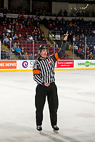 KELOWNA, CANADA - JANUARY 25: Referee Mike Campbell stands on the ice against the Victoria Royals on January 25, 2019 at Prospera Place in Kelowna, British Columbia, Canada.  (Photo by Marissa Baecker/Shoot the Breeze)