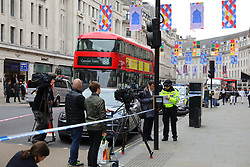 © Licensed to London News Pictures. 05/06/2018. London, UK. Police outside Watches of Switzerland on Regent Street after it was attacked by a gang on mopeds. It is being reported that the attackers were armed with knives. Photo credit: Rob Pinney/LNP