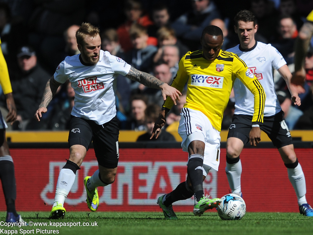 Derby Richard Keogh, holds of Brentfords Moses Odubajo, Derby County v Brentford, Sy Bet Championship, IPro Stadium, Saturday 11th April 2015. Score 1-1,  (Bent 92) (Pritchard 28)<br /> Att 30,050