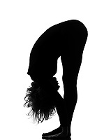 woman sun salutation yoga surya namaskar posture position in silouhette on studio white background full length