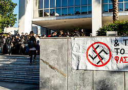 Protestors hold banners as they take part in an anti-fascist rally outside the Court of Appeal during the testify of former MP and leader of Golden Dawn party Nikolaos Michaloliakos, on November 6, 2019, in Athens.<br /> <br /> Pictured: <br /> Dimitris Lampropoulos  | EEm date
