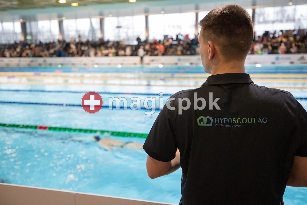A coach wearing a black polo-shirt with a  HYPOSCOUT AG print on the back is seen during the International Long Course Swim Meet Uster 2017 held at the Hallenbad Buchholz in Uster, Switzerland, Sunday, Feb. 5, 2017. (Photo by Patrick B. Kraemer / MAGICPBK)