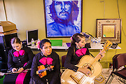 13 MAY 2012 - PHOENIX, AZ: Mariachi Rubor warms up before performing at the Puente office in Phoenix, AZ, on Mothers' Day.    PHOTO BY JACK KURTZ