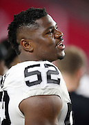 Oakland Raiders defensive end Khalil Mack (52) looks on from the sideline during the 2016 NFL preseason football game against the Arizona Cardinals on Friday, Aug. 12, 2016 in Glendale, Ariz. The Raiders won the game 31-10. (©Paul Anthony Spinelli)