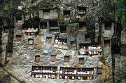 Tau tau figures mark the entrances to tombs carved into the rocky cliff face, Tana toraja, Sulawesi, Indonesia