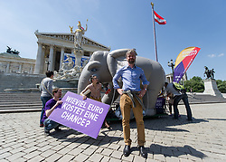 22.05.2014, Parlament, Wien, AUT, Europa Anders, Europa Anders drehen Elefantenrunde durch Wien. im Bild Europa Anders Spitzenkandidat zur EU-Wahl und Europaabgeordneter Martin Ehrenhauser vor dem Parlament // Europa Anders Topcandidate for EU-Election and MEP Martin Ehrenhauser with elephant during protest action of Europa Anders in front of Austrian Parliament in Vienna, Austria on 2014/05/22. EXPA Pictures © 2014, PhotoCredit: EXPA/ Michael Gruber
